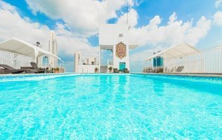 Piscina Hotel City House Soloy & Casino